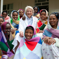 Catherine surrounded by women in Ethiopia smiling together